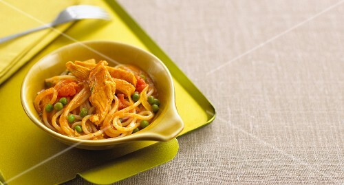 Noodles with curry sauce, chicken and vegetables