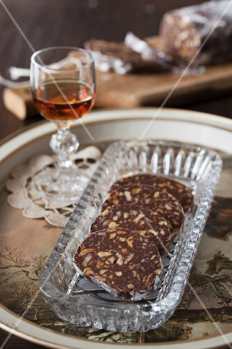 Chocolate Biscuit Salami with Walnuts and Rum (no bake) on cristal plate with brandy