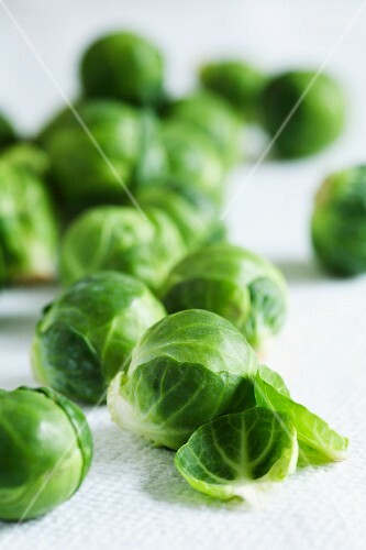Brussels sprouts on a white surface