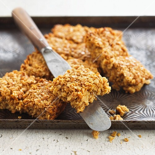 Flapjacks on a baking tray with a pallet knife