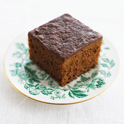 A piece of ginger cake on a plate