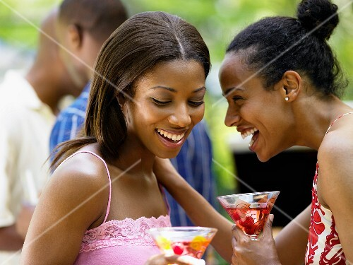Young women laughing together
