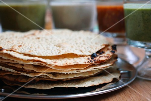 Stack of papadums on a platter