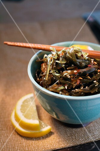 Bowl of seaweed salad with chopsticks