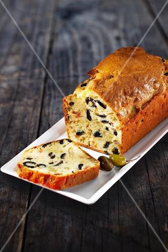 Olive cake, partly sliced