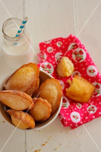 Madeleines, with a bottle of milk to one side