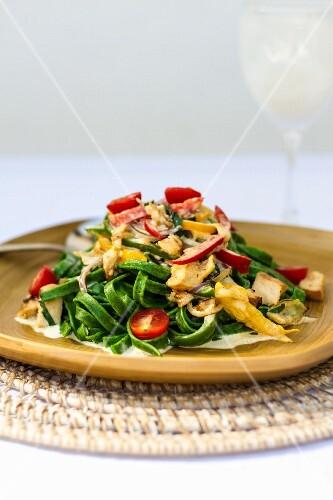 Green tagliatelle with chicken ragout