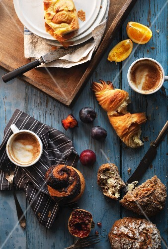 Breakfast Table with white bread, Croissant, cinnamon snail , Fruit, coffee