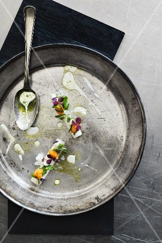 Danish white asparagus with onion roe, buttermilk and wild herbs.