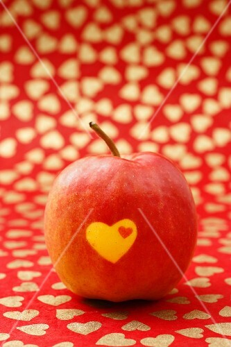 A red apple with hearts