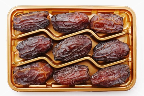 Dried Medjool dates in plastic packaging