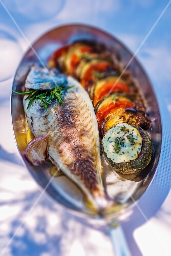 Baked gilt-head bream with aubergines, tomatoes and herb butter