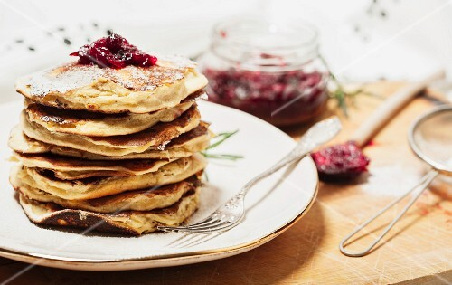 Stacked pancakes with cranberry jam