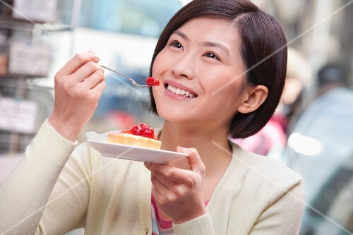 Chinese woman eating pie