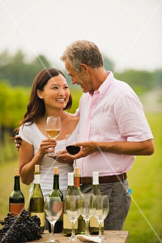 Couple tasting wine together outdoors