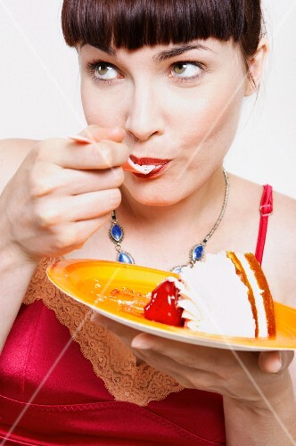 Close up of woman eating cake