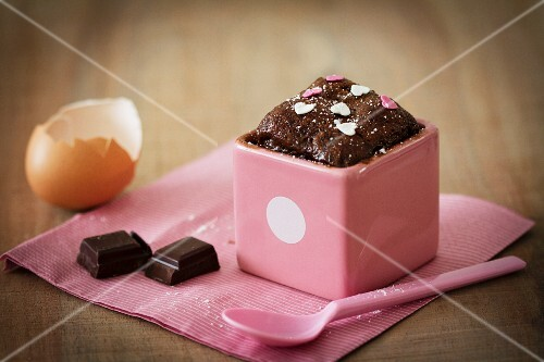 Mini chocolate cake with sugar hearts, and ingredients