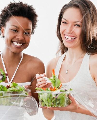 Friends eating salad