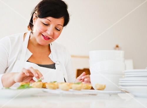 Smiling Hispanic woman baking