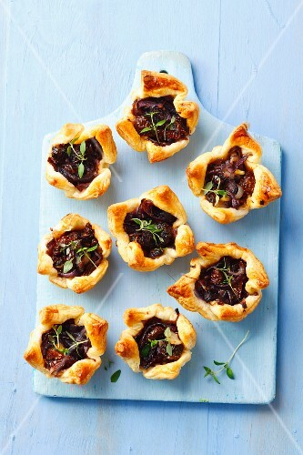 Puff pastry tartlets with caramelised red onions, sundried tomatoes and thyme