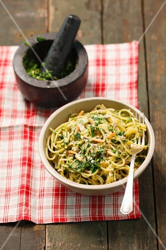 Spaghetti with parsley pesto and pine nuts