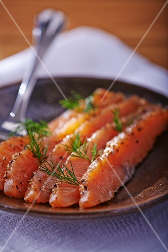 Slices of smoked salmon with dill