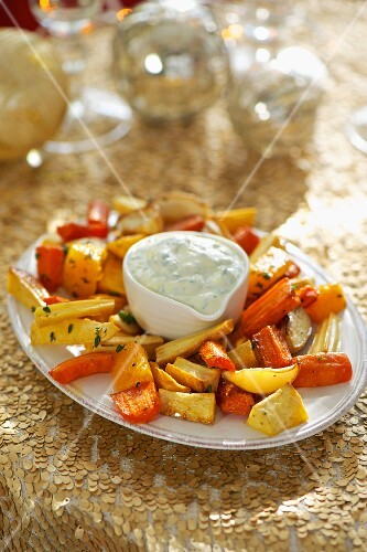 Oven-roasted root vegetables with a herb dip
