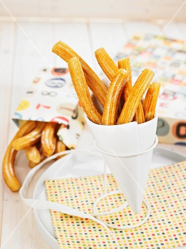 Churros in a paper cone to take away