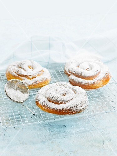 Ensaimadas (spiral pastries, Spain) dusted with icing sugar