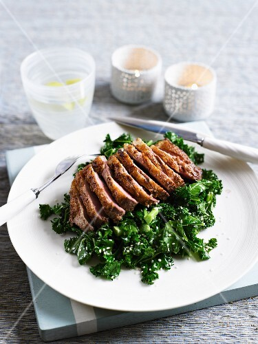 Duck breast with ginger, kale and sesame seeds
