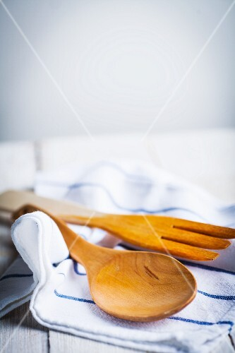 Wooden cooking utensils on a tea towel