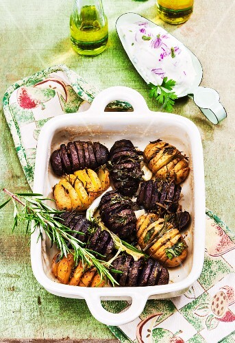 Yellow and purple Hasselback potatoes with rosemary