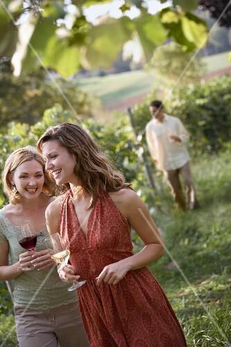 EditFriends Enjoying Wine While Walking Through Vineyard, Rocheport, Missouri