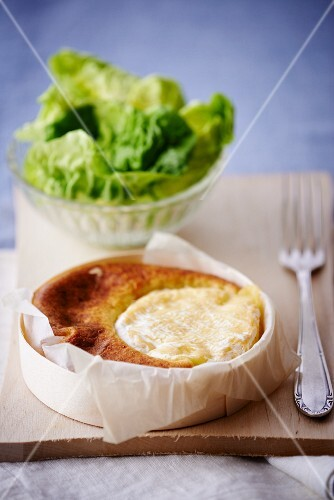 Baked Saint Marcellin cheese with lettuce