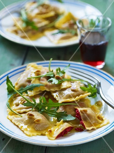 Ravioli with beetroot filling, pine nuts and rocket