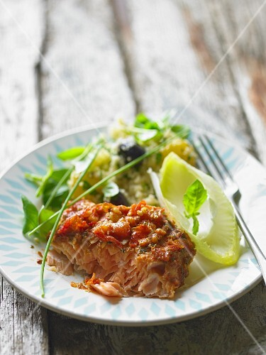 A serving of baked salmon with crisp topping