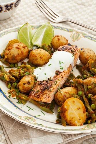 Salmon with roast potatoes, peas and yoghurt sauce