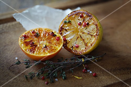 Glazed orange and lemon with pink peppercorns and thyme