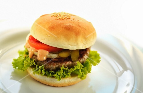 Hamburger with onions and pickled gherkins