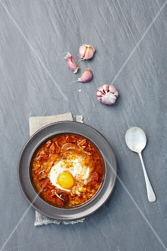 Garlic soup with chorizo and egg