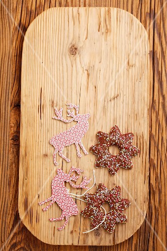 Lebkuchen stars (spiced soft gingerbread from Germany) and Christmas tags on a chopping board