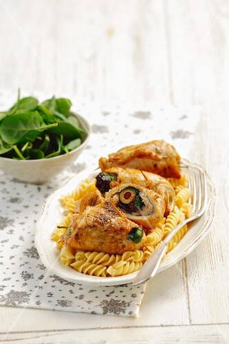 Rolled strips of turkey stuffed with olives, sundried tomatoes and spinach, served with pasta