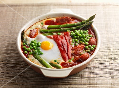 Baked eggs red pepper asparagus peas and chorizo