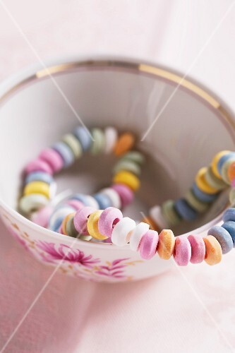 Colourful candy necklace in a mug