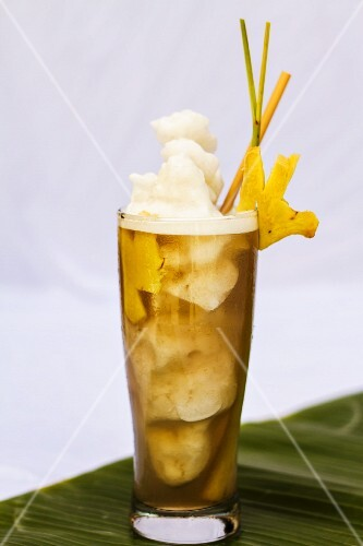 Fruity drink with ice cream and pineapple