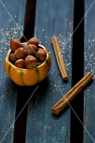 Hazelnuts and cinnamon sticks