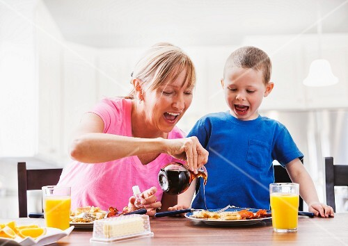 A mother and son having breakfast