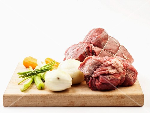 Fresh beef and soup vegetables on a chopping board
