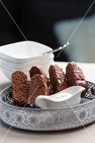 Pieces of chocolate Bundt cake with cream