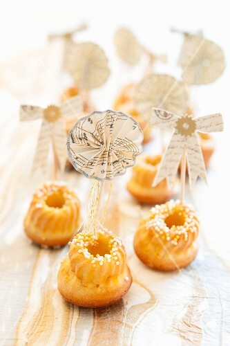 Mini Bundt cakes with sugar crystals and party decoration